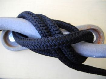 A proper cleat knot looks as if two rivers are flowing under a bridge when the line is looped around the cleat correctly.